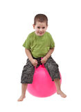Boy jumping. On a large ball Stock Photos