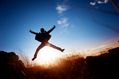Boy jumping. Silhouette of boy jumping and landscape Royalty Free Stock Photography