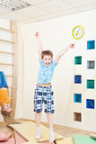 Boy jumping. Happy boy jumping in the gym Stock Image