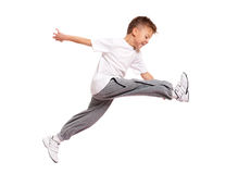 Boy jumping. Happy little boy jumping isolated on white background Stock Image