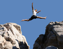 Boy jumping. Over the mountains Royalty Free Stock Images