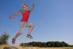 Boy jumping. In the air Royalty Free Stock Photo