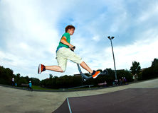 Boy jumping in the air Royalty Free Stock Photos
