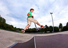 Boy jumping in the air with his Royalty Free Stock Image