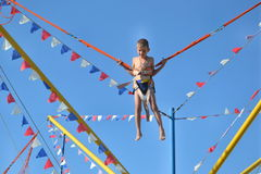 Boy jumping on amusement. Entertainment leisure stock photo