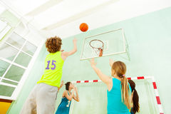 Boy Jumping And Throwing Ball Into The Basket Royalty Free Stock Photos