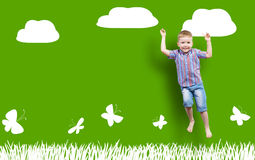 Boy jumping on the background of painted wall Stock Images