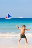 Boy jumping on beach Royalty Free Stock Photo