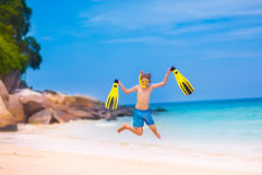 Boy jumping on a beach. Happy little boy jumping on a beautiful tropical beach enjoying snorkeling on a exotic island during summer vacation Stock Photography