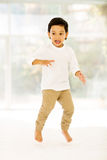 Boy jumping bed Royalty Free Stock Photography