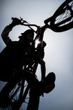 Boy jumping bike contrast BMX 3 Royalty Free Stock Photos