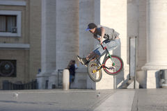 Boy jumping with bike Stock Photos