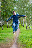 Boy jumping in  birch forest Stock Photo