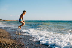 Boy jumping on the Black Sea coast in Crimea Royalty Free Stock Photo