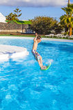 Boy  jumping in the blue pool Royalty Free Stock Photography