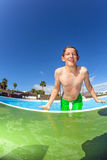 Boy  jumping in the blue pool Royalty Free Stock Photos