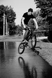 Boy jumping  on bmx. Summer early morning sunny weather clear sky  balck and white photo Stock Image