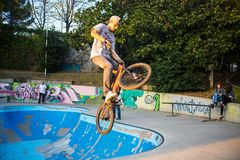 Boy jumping with BMX bike on a BMX session in the city. stock images