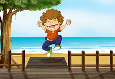 A boy jumping in the bridge Royalty Free Stock Image