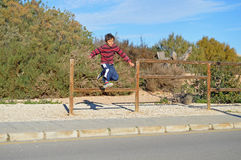 Boy Jumping A Fence Royalty Free Stock Photography