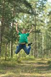 Boy jumping in forest Stock Photos