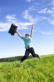 Boy jumping on a green meadow Royalty Free Stock Image