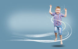 Boy jumping hands up Royalty Free Stock Photography
