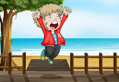 A boy jumping happily in the bridge Royalty Free Stock Photography