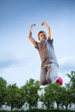 Boy jumping high Royalty Free Stock Image