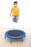 Boy jumping high on trampoline Royalty Free Stock Image