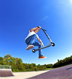 Boy jumping with his scooter Royalty Free Stock Photo