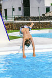 Boy Jumping In The Blue Pool Stock Photo
