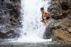 Boy Jumping Into Water Stock Photography
