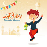 Boy Jumping with Lantern Celebrating Ramadan Royalty Free Stock Image