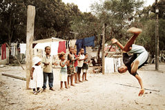 Boy jumping, making a salto in township, South Africa. Royalty Free Stock Photos