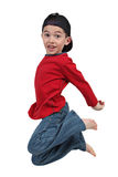 Boy jumping in midair. Happy young preschool boy jumping midair, isolated on white background stock images