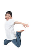 Boy jumping midair Stock Images