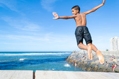 Boy jumping in the ocean #1 royalty free stock photos
