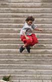 Boy jumping off building royalty free stock photography