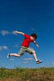 Boy jumping outdoor stock images