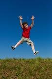 Boy jumping outdoor Stock Photos