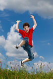 Boy jumping outdoor Stock Image