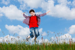 Boy jumping outdoor Royalty Free Stock Images