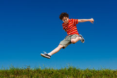 Boy jumping outdoor Stock Photos