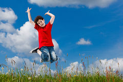 Boy jumping outdoor Royalty Free Stock Image