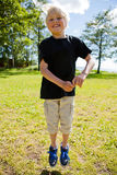 Boy jumping outdoors Royalty Free Stock Image
