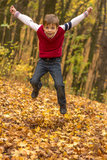 Boy jumping in the outumn forrest Royalty Free Stock Image