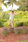 Boy jumping over a bush Royalty Free Stock Photo