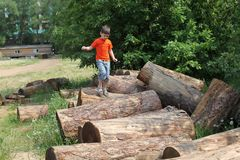 Boy jumping over logs Stock Photo