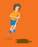 Boy jumping on pogo stick towards pit or hole Stock Images